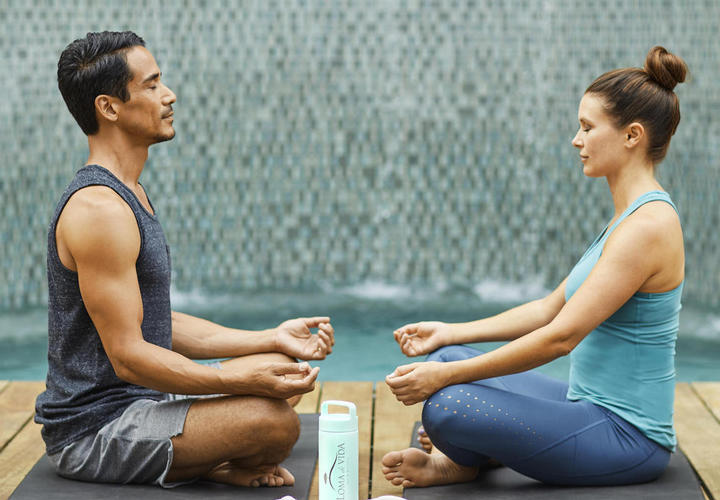 couple doing meditation together